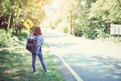 Beautiful woman backpack relaxing on the road. Vacation time and summer Royalty Free Stock Photo