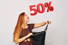 Beautiful woman with bag. Sale concept. Royalty Free Stock Image