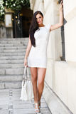Beautiful woman with bag in the street Stock Image