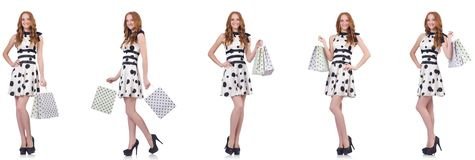 The beautiful woman with bags isolated on white royalty free stock photos