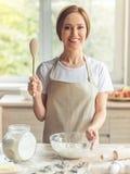 Beautiful woman baking Stock Photos