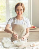 Beautiful woman baking Royalty Free Stock Photography