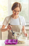 Beautiful woman baking Royalty Free Stock Images