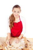 Beautiful woman is baking cookies for christmas Royalty Free Stock Image