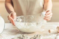 Beautiful woman baking Stock Image