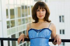 Beautiful fashion woman on a balcony. Of apartment Stock Image