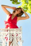 Beautiful woman on the balcony Stock Photo
