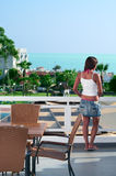 Beautiful woman at balcony of hotel Royalty Free Stock Photo