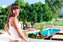 Beautiful woman at balcony of hotel Stock Photos
