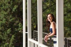 Beautiful Woman On Balcony Stock Photo