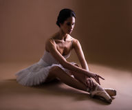 Beautiful woman ballet dancer in tutu relaxing after training Royalty Free Stock Image