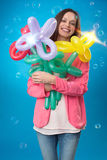 Beautiful woman with balloon flowers Stock Photo