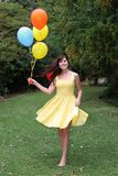Beautiful Woman and Balloons Stock Image