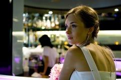 Beautiful woman in bar Stock Image