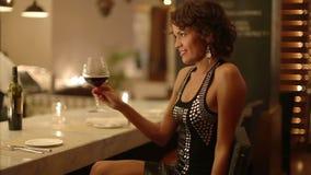 Beautiful woman in bar stock footage