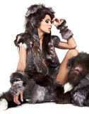 Beautiful woman in barbarian costume Stock Images