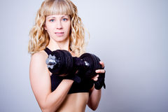 Beautiful woman with a barbell Stock Photos