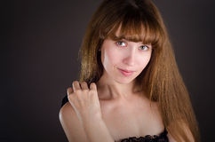 The beautiful woman with the bared shoulders. Royalty Free Stock Photo