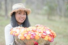 Beautiful woman with  basket of colorful flower. Walking in the forest Royalty Free Stock Photography
