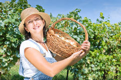 Beautiful woman with basket of onions Stock Photo