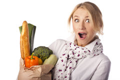 Beautiful woman and basket with vegetables Royalty Free Stock Image