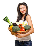 Beautiful woman and basket with vegetables Royalty Free Stock Photo