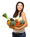 Beautiful woman and basket with vegetables Stock Photography