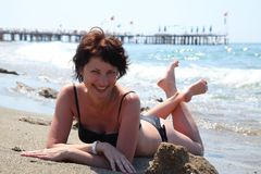 A beautiful woman is basking in the sun in the sea. Royalty Free Stock Photo