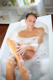 Beautiful woman in bath stock images