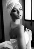 Beautiful woman after bath. Black and white photo of sensual woman after bath or shower standing in her bathroom. Spa skin care beauty woman wearing hair towel Royalty Free Stock Photography