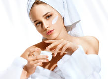 Beautiful woman after bath cares about her face Stock Images