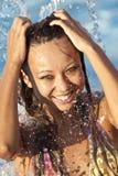 Beautiful woman bathes in pool Stock Photo