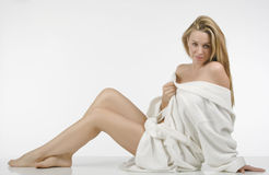Beautiful woman in bathrobe. Beautiful blonde woman with long legs Stock Image