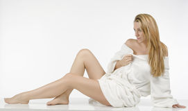Beautiful woman in bathrobe. Beautiful blonde woman whit long legs Royalty Free Stock Photos
