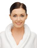 Beautiful woman in bathrobe Stock Images