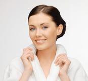 Beautiful woman in bathrobe Stock Image