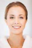 Beautiful woman in bathrobe. Bright closeup portrait picture of beautiful woman in bathrobe Royalty Free Stock Photography