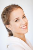 Beautiful woman in bathrobe. Bright closeup portrait picture of beautiful woman in bathrobe Stock Photography