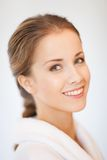 Beautiful woman in bathrobe. Bright closeup portrait picture of beautiful woman in bathrobe Royalty Free Stock Image