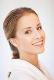 Beautiful woman in bathrobe. Bright closeup portrait picture of beautiful woman in bathrobe Royalty Free Stock Photo