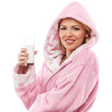 Beautiful woman in a bathrobe with a glass of milk Stock Photography