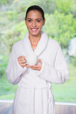 Beautiful woman in bathrobe having tea outdoors Royalty Free Stock Photography