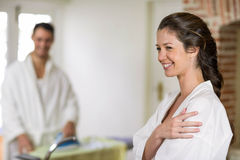 Beautiful woman in bathrobe looking away and smiling Stock Photo