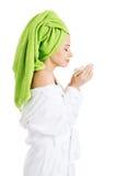 Beautiful woman in bathrobe and turban. Stock Photography