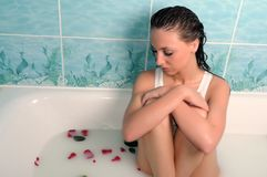 Beautiful woman in a bathroom Royalty Free Stock Images