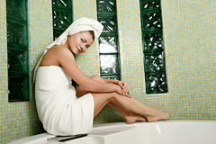Beautiful woman in a bathroom royalty free stock photography