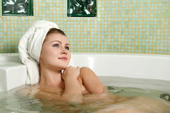 Beautiful woman in a bathroom stock images