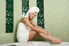 Beautiful woman in a bathroom Stock Photos