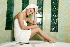 Beautiful woman in a bathroom Stock Image