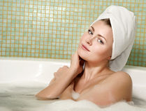 Beautiful woman in a bathroom Stock Photo